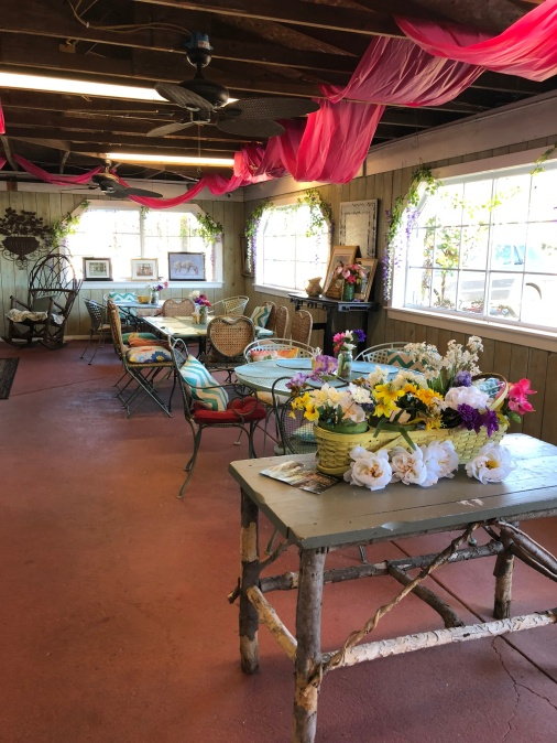 "The ""outdoor"" dining area is located inside an enclosed porch in the Red Barn."